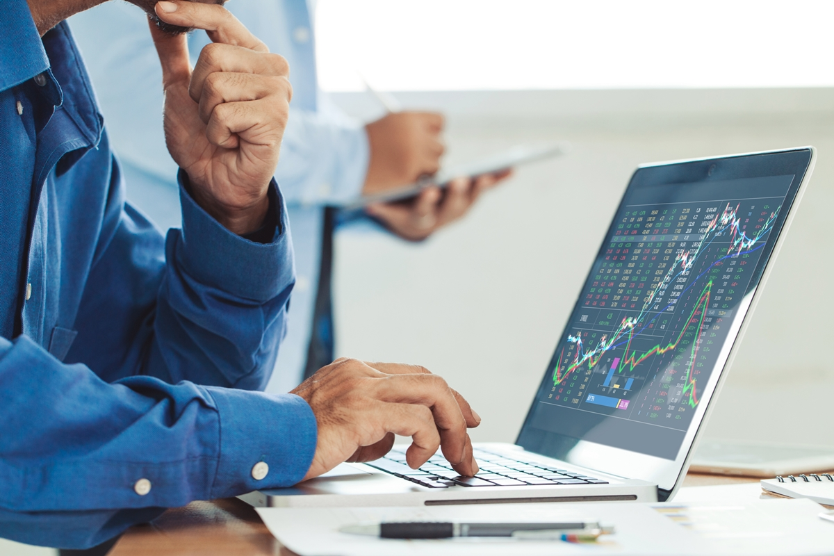 Businessman analyzing stock market report and financial dashboar
